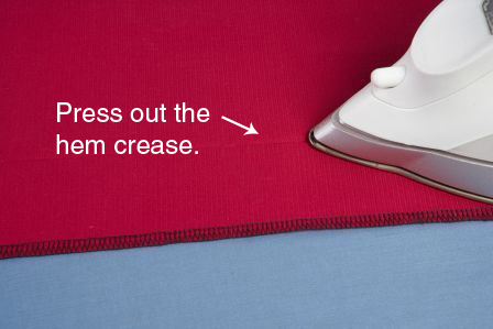Remove the original stitching and press out the hem