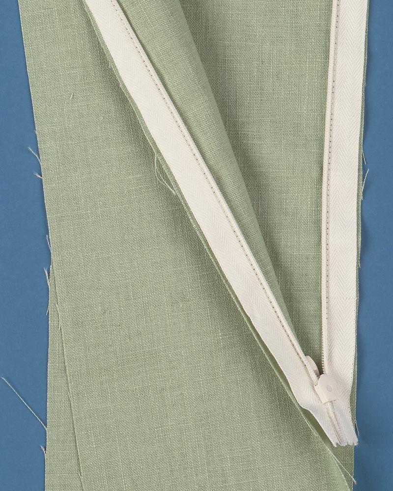 Sew zipper to garment