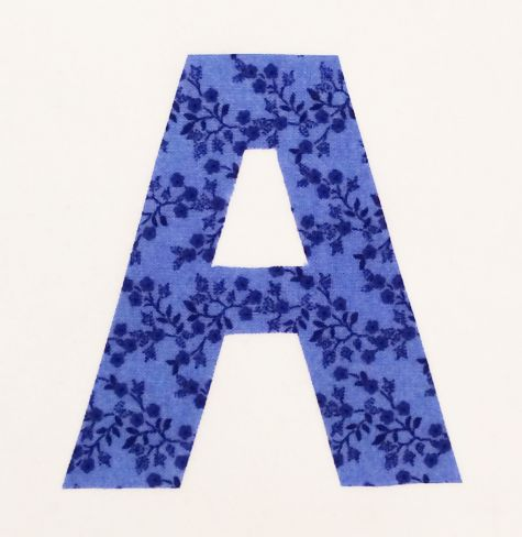 Adhere letter to fabric