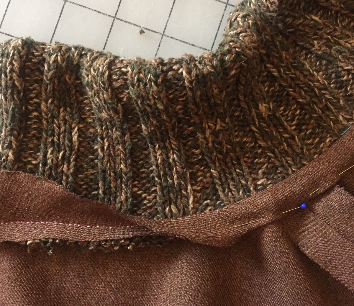 Wrap the bias strip over the trimmed seam allowances