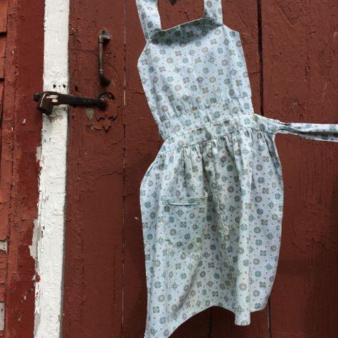 Child's blue apron